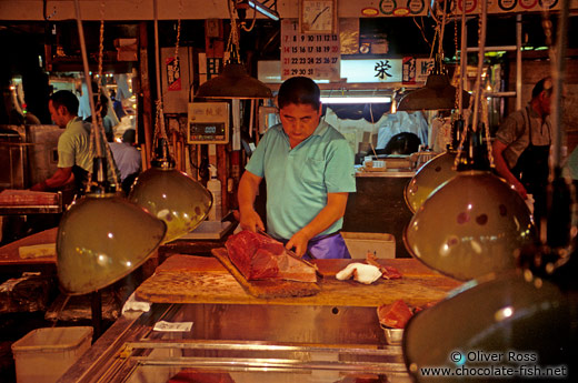 Cutting the catch of the day at the Tsukiji fishmarket in Tokyo
