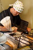 Travel photography:Preparing small biscuits in a street bakery in Kyoto´s Gion district, Japan