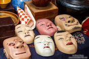 Travel photography:Masks for sale at Tokyo´s Antiques market, Japan