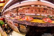 Travel photography:Fresh sushi arrive on a conveyor belt in a Tokyo restaurant, Japan
