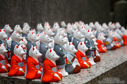 Small figurines of foxes at Kyoto´s Inari shrine