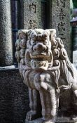 Travel photography:Stone dog sculpture at Kyoto´s Inari shrine, Japan