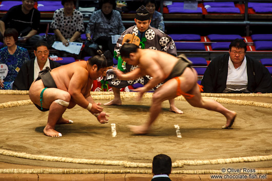 Makushita ranked wrestlers in a bout at the Nagoya Sumo Tournament