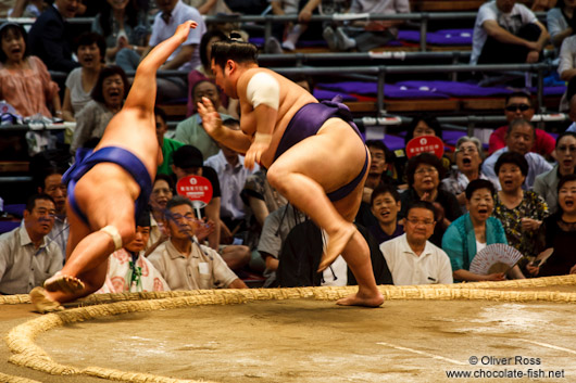 Throwing the opponent out of the ring at the Nagoya Sumo Tournament