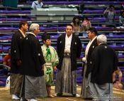 Travel photography:The five shimpan (judges) usually seated around the ring meet in the center to hold a mono-ii at the Nagoya Sumo Tournament, Japan
