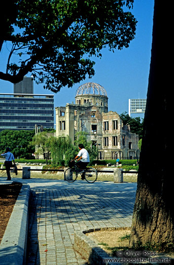 Cyclist in front of The Atomic Bomb Dome in Hiroshima