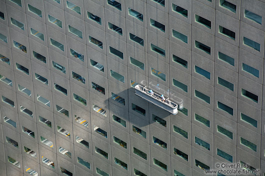 Window cleaners at a skyscraper in Tokyo´s Shinjuku district