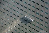 Travel photography:Window cleaners at a skyscraper in Tokyo´s Shinjuku district, Japan