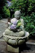 Travel photography:Buddha with flower offerings in Kamakura, Japan