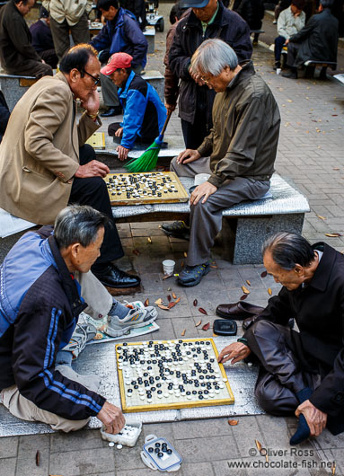 Old men playing Go in a park near the Jongmyo Royal Shrine in Seoul