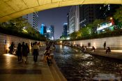 Travel photography:Couple promenade along the Cheonggyechon stream in Seoul, South Korea