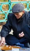 Travel photography:Old man playing Go in a park near the Jongmyo Royal Shrine in Seoul, South Korea