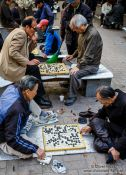 Travel photography:Old men playing Go in a park near the Jongmyo Royal Shrine in Seoul, South Korea