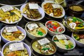 Travel photography:Food dishes for sale at a restaurant on the Seoul night market, South Korea