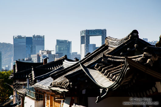 View of the modern high rises from Seoul`s Bukchon Hanok village