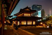 Travel photography:Seoul Deoksugung palace with part of city skyline and Seoul Tower, South Korea