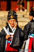 Travel photography:Man on mobile at the Jongmyo Royal Shrine in Seoul, South Korea