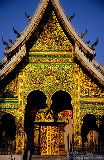 Facade of the Haw Pha Bang temple in the evening light
