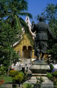 Travel photography:King Sisavang Vong Statue in the Palace Grounds in Luang Prabang, Laos