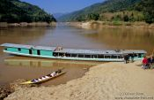 Travel photography:People transport boat on the Mekong River, Laos