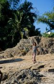 Travel photography:Woman on the banks of the Mekong River, Laos