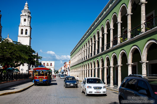 Colonnades along the main square in Campeche with church