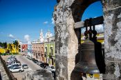 Travel photography:View of Campeche from the city walls with alarm bell, Mexico