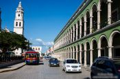 Travel photography:Colonnades along the main square in Campeche with church, Mexico