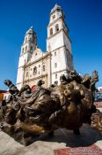 Travel photography:Campeche church with sculpture by Mexican artist Jose Luis Cuevas, Mexico