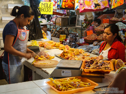 Selling chicken at the Oaxaca market