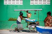 Travel photography:Seller on bike in Celestun, Mexico