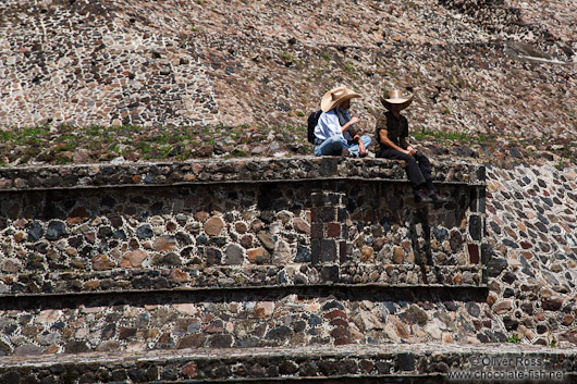 People sitting at the base of the sub pyramid at the Teotihuacan archeological site