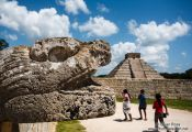 Travel photography:Snake head with pyramid at the Chichen Itza archeological site, Mexico