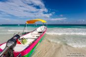 Travel photography:Tourist boat on Tulum beach, Mexico