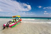 Travel photography:Tourists at Tulum beach, Mexico
