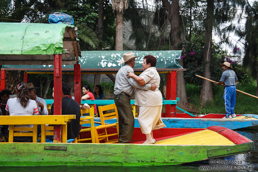 Dancing to the tune of the Mariachi on one of the colourful trajineras (rafts) on Lake Xochimilco
