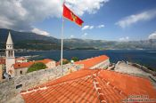 Travel photography:View from Budva castle with Montenegrin flag, Montenegro