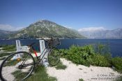 Travel photography:Bike overlooking Perast bay (Boka Kotorska), Montenegro