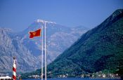 Travel photography:View of mountain range with Montenegrin flag, Montenegro