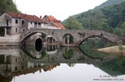 Travel photography:Ancient bridge in Rijeka-Crnojevica dating from the time of Turkish domination, Montenegro