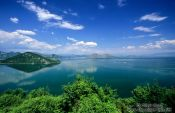 Travel photography:View of Skadarsko jezero (Scutari lake) with isolated monastery, Montenegro