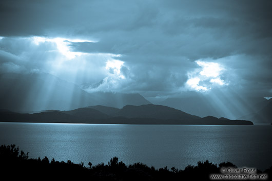 Rays of light break through the clouds in Fiordland National Park