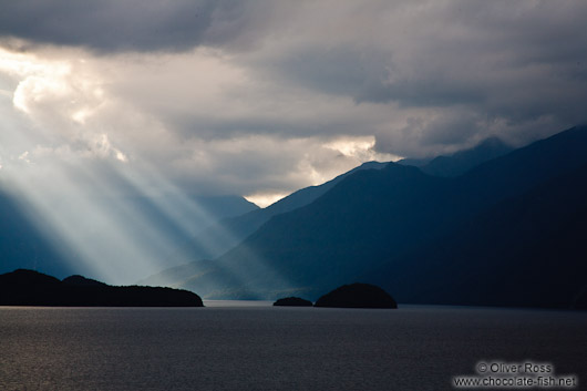 Rays of light break trough the clouds in Fiordland National Park