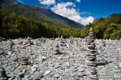 Travel photography:Stone pyramids in a river bed in Mount Aspiring National Park, New Zealand