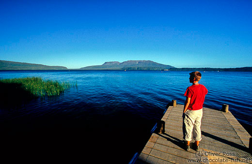 View of lake Tarawera with the dormant volcano of Mt Tarawera in the background
