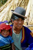 Travel photography:Uros mother with child, Peru