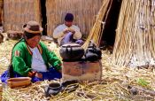 Travel photography:Uros woman cooking, Peru