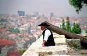 Travel photography:Man in traditional dress in Lisbon`s São Jorge Castle, Portugal