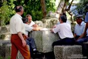 Travel photography:Men Playing Cards in Lisbon`s São Jorge Castle, Portugal