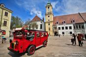 Travel photography:Tourist bus in Bratislava´s city centre with old town hall, Slovakia